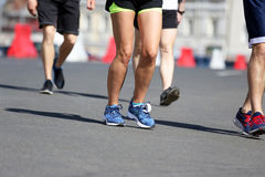 Legs running athletes on the course. The legs running athletes on the course Royalty Free Stock Photography