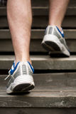 Legs of running man on stairs. Legs of running man on wooden stairs stock image