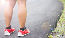 Legs and Running Shoe Closeup Of Man Jogging Outdoors On Public Park Stock Photography