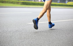 Legs running on street Stock Photo
