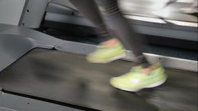 Legs running on a treadmill gym stock video footage