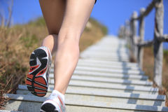 Legs running up on mountain Royalty Free Stock Photos