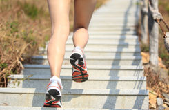 Legs running up on mountain stairs Stock Image
