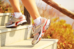 Legs running up on mountain stairs Stock Photography