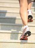 Legs running up on mountain stairs Stock Images