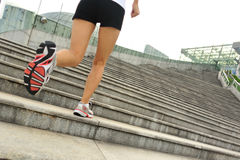Legs running up on stone stairs Royalty Free Stock Image