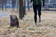 Legs of a running woman in the cold winter Stock Photo