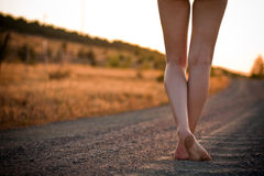 Legs on rural road stock image