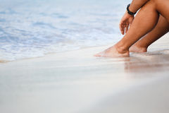 Legs on sandy beach Stock Photo