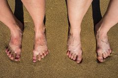 Legs on a sandy beach in Palma de Mallorca, Spain.  Royalty Free Stock Photography