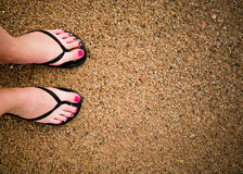 Legs on sandy beach. Slim girl's legs on sandy beach stock photography
