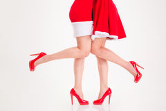 Legs in santa claus costumes and red high heels shoes Royalty Free Stock Photo