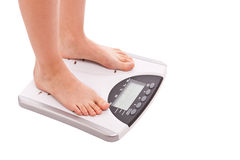 Legs on scales Royalty Free Stock Photo