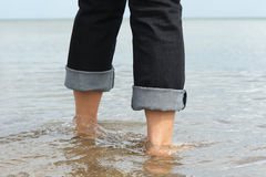 Legs in sea. Royalty Free Stock Image