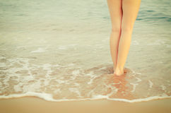 Legs on a seashore Stock Photos