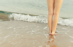 Legs on a seashore Stock Images