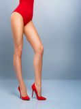 Legs of a sexy Santa girl in a red Christmas swimsuit Royalty Free Stock Images