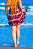 Legs of sexy woman walking into the sea Royalty Free Stock Photography