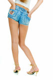Legs of sexy young woman in shorts Stock Photography