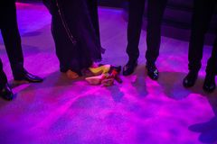 Legs in shoes, barefoot and shoes at a wedding party Stock Photography