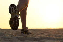 Legs and shoes of a man running at sunset. With the horizon in the background royalty free stock photography