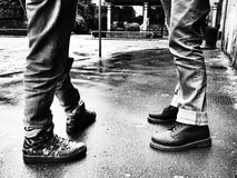 Legs of two men talking Stock Photo