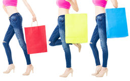 Legs of shoppers with shopping bags Royalty Free Stock Photos