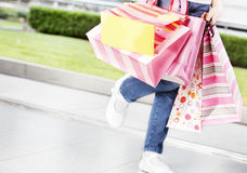 Legs and shopping bags Stock Photos