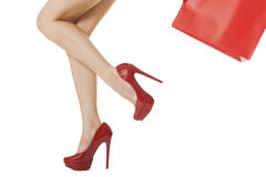 Legs Shot - Woman Legs with Flawless Skin in Red High Heels Stock Photo