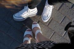 Legs on a sidewalk tile. Close-up of girls legs on a sidewalk tile Stock Photos