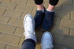 Legs on a sidewalk tile. Close-up of girls legs on a sidewalk tile Royalty Free Stock Images
