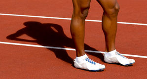 Legs and silhouette on track sport Stock Images