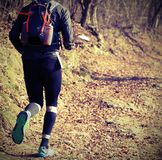 Runner during cross-country race. Legs of a single fast runner during cross-country running Royalty Free Stock Photos