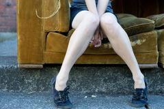 Legs sitting on a couch royalty free stock images