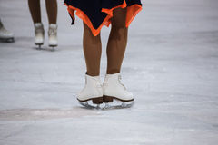 The legs of skater on ice Royalty Free Stock Photo