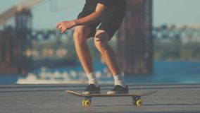 Legs of skater performing trick. stock video footage