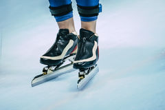 Legs of skater in skating. Closeup foot male speed skaters in ice skating Royalty Free Stock Photography