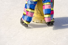 Legs in skates on ice ring royalty free stock photo