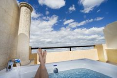 Legs in the sky. Out of the hot tube Stock Photography