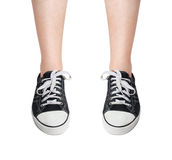 Legs in sneakers Stock Photos