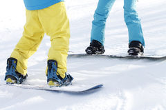 Legs snowboarder, active sports royalty free stock photography