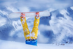 Legs of a snowboarder upside down royalty free stock photos