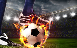 Legs of soccer or football player. At stadium stock image