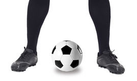 Legs of soccer player with ball on white Stock Photo