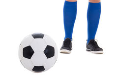 Legs of soccer player in blue kneesocks with ball isolated on wh Stock Images