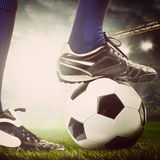 Legs of a soccer player Stock Image