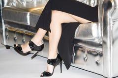 Legs on sofa Royalty Free Stock Photography