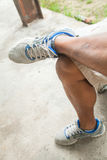 Legs and sport shoes Stock Image
