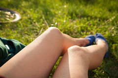 Legs in sport shoes on grass Stock Image