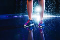 Legs with sports sneakers Royalty Free Stock Image
